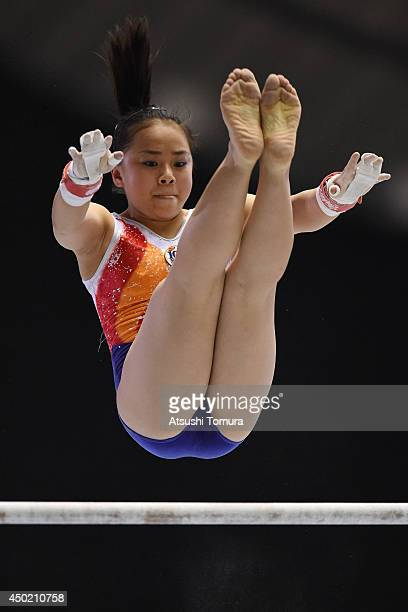 Mai Murakami of Japan competes in the Uneven Bars during day one of the Artistic Gymnastics NHK Trophy at Yoyogi National Gymnasium on June 7 2014 in...