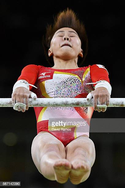 Mai Murakami of Japan competes on the uneven bars during Women's qualification for Artistic Gymnastics on Day 2 of the Rio 2016 Olympic Games at the...
