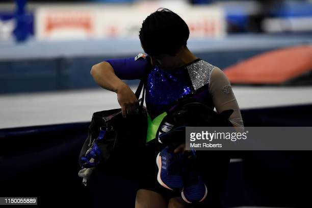 Mai Murakami of Japan leaves the arena after withdrawing from competition on day one of the Artistic Gymnastics NHK Trophy at Musashino Forest Sport...