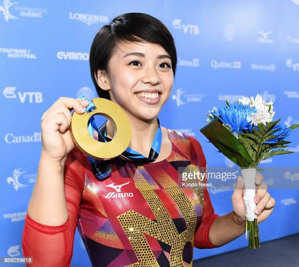 Mai Murakami of Japan poses with her gold medal after winning the women's floor exercise at the world gymnastics championships in Montreal Canada on...