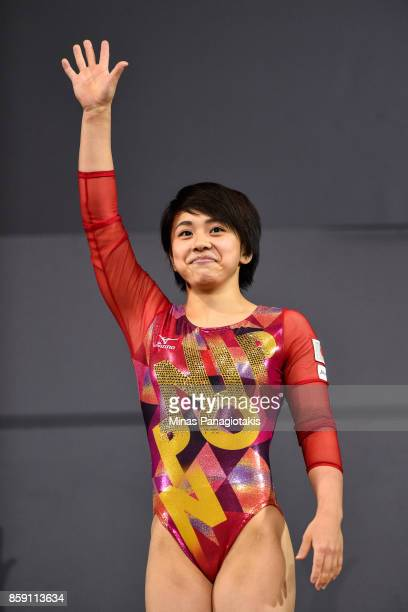 Mai Murakami of Japan shows her appreciation towards the fans after finishing first on the floor exercise during the individual apparatus finals of...