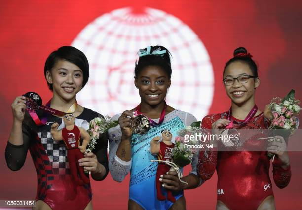 Mai Murakami of Japan Siver Medalist Simone Biles of USA Gold Medalist and Morgan Hurd of USA Bronze Medalist celebrate after the Women's AllRound...
