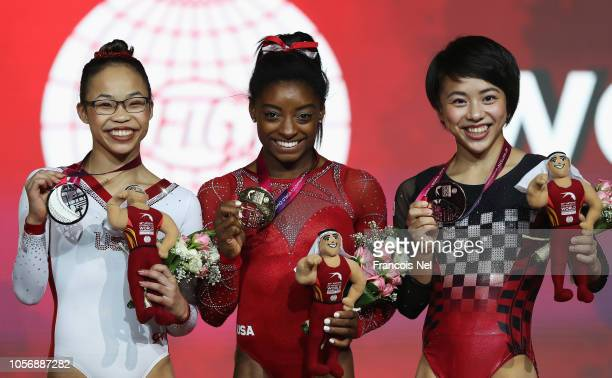 Mai Murakami of Japan with Bronze Simone Biles of USA with Gold and Morgan Hurd with Silver medals pose after the Womens Floor Final during day ten...