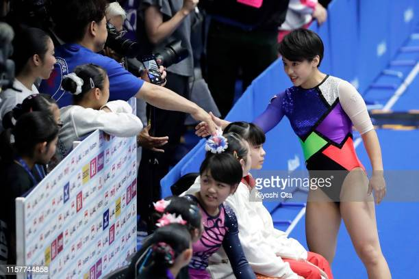 Mai Murakami reacts after competing in the Women's Vault final on day two of the 73rd All Japan Artistic Gymnastics Apparatus Championships at...