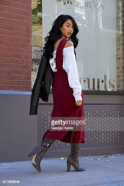 Mai Nguyen wearing red Forever 21 midi apron dress with slit white cotton Windsor Store off the shoulder oversized pullover sweater with lattice back...