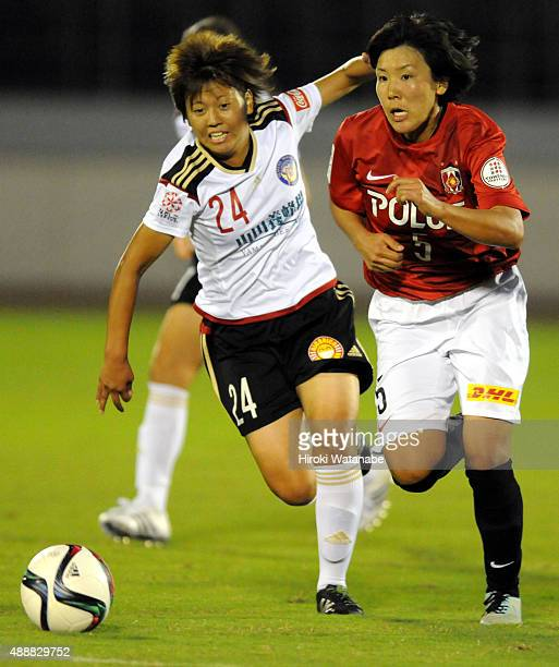 Mai Okubo of Yunogo Belle and Natsuki Kishikawa of Urawa Reds Ladies compete for the ball during the Nadeshiko League match between Urawa Red...