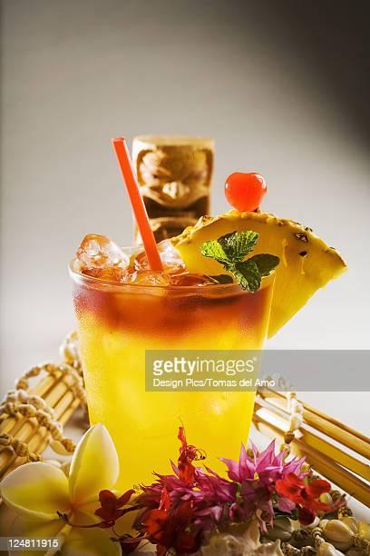 a mai tai garnished with pinapple and a cherry. - mai tai fotografías e imágenes de stock