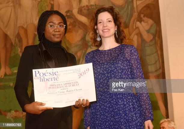 Maia Brami awards Corine Andrea Owona during Poesie En Liberté 2019 Awards Ceremony At Mairie Du 5eme on November 23 2019 in Paris France