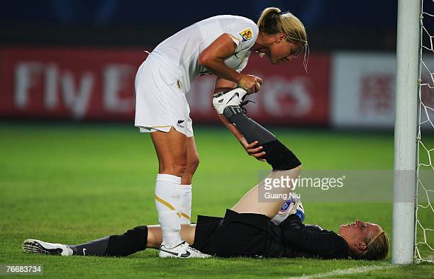 Maia Jackman of New Zealand gives a help to her teammate Jenny Bindon during the FIFA Women's World Cup 2007 Group D match against Brazil at Wuhan...