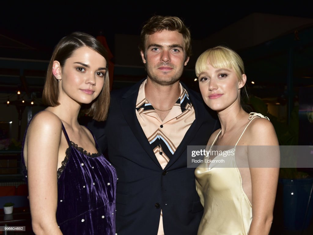 Maia Mitchell, Alex Roe, and Maika Monroe pose for portrait at the screening of A24's 'Hot Summer Nights' afterparty on July 11, 2018 in Los Angeles, California.