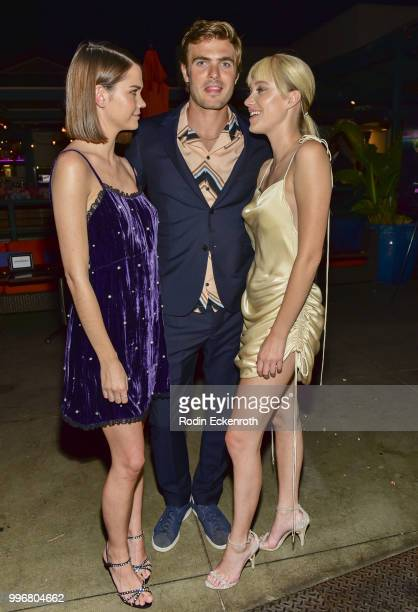 Maia Mitchell Alex Roe and Maika Monroe pose for portrait at the screening of A24's 'Hot Summer Nights' afterparty on July 11 2018 in Los Angeles...