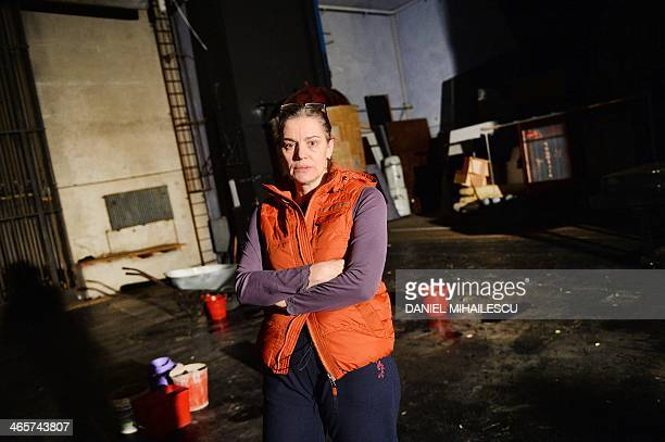 Maia Morgenstern the director of the Romanian State Jewish Theatre stands on the stage next to the buckets collecting water leaking from the roof in...
