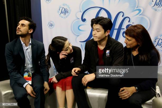 Maia Shibutani and Alex Shibutani react to their scores in the kiss and cry with their coaches Massimo Scali and Marina Zoueva after skating in the...