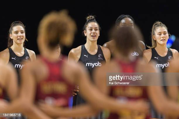 Maia Wilson of New Zealand and her team mates line up for their national anthem prior to game two of the Cadbury Netball Series between the New...