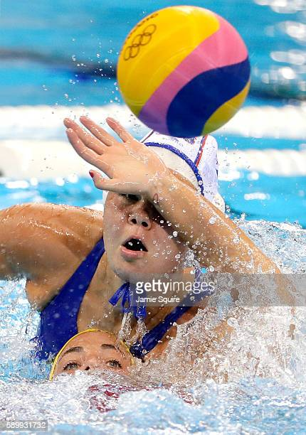 Maica Garcia Godoy of Spain and Maria Borisova of Russia compete for the ball during their quarterfinal match at the Rio 2016 Olympic Games on August...