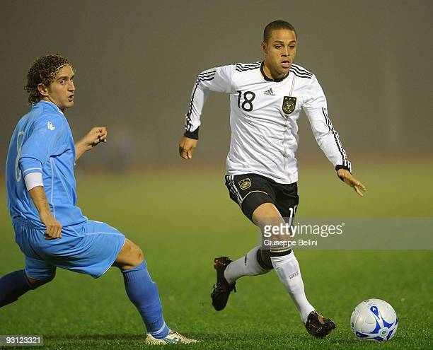 Maicol Berretti of San Marino and Sidney Sam of Germany battle for the ball during the UEFA Under 21 Championship match between San Marino and...