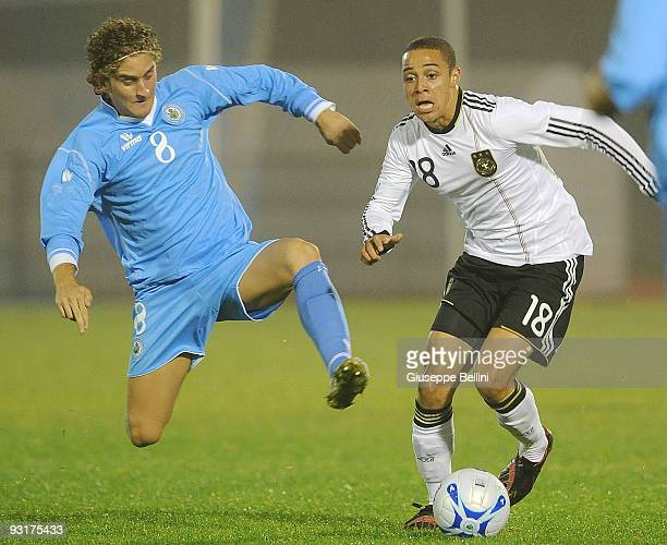 Maicol Berretti of San Marino and Sidney Sam of Germany in action during the UEFA Under 21 Championship match between San Marino and Germany at...
