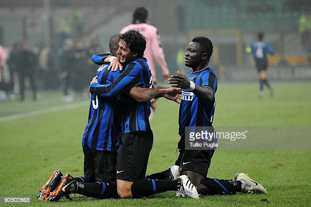 Maicon, Diego Milito and Sulley Muntari of Inter Milan celebrate their 5th goal during the Serie A match between FC Internazionale Milano and US...