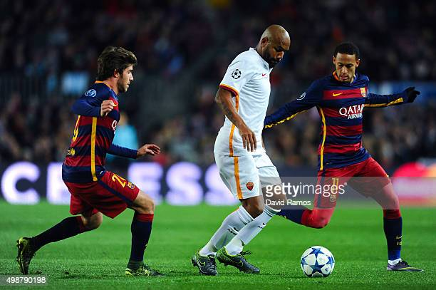 Maicon of AS Roma competes for the ball with Sergio Roberto and Neymar of FC Barcelona during the UEFA Champions League Group E match between FC...