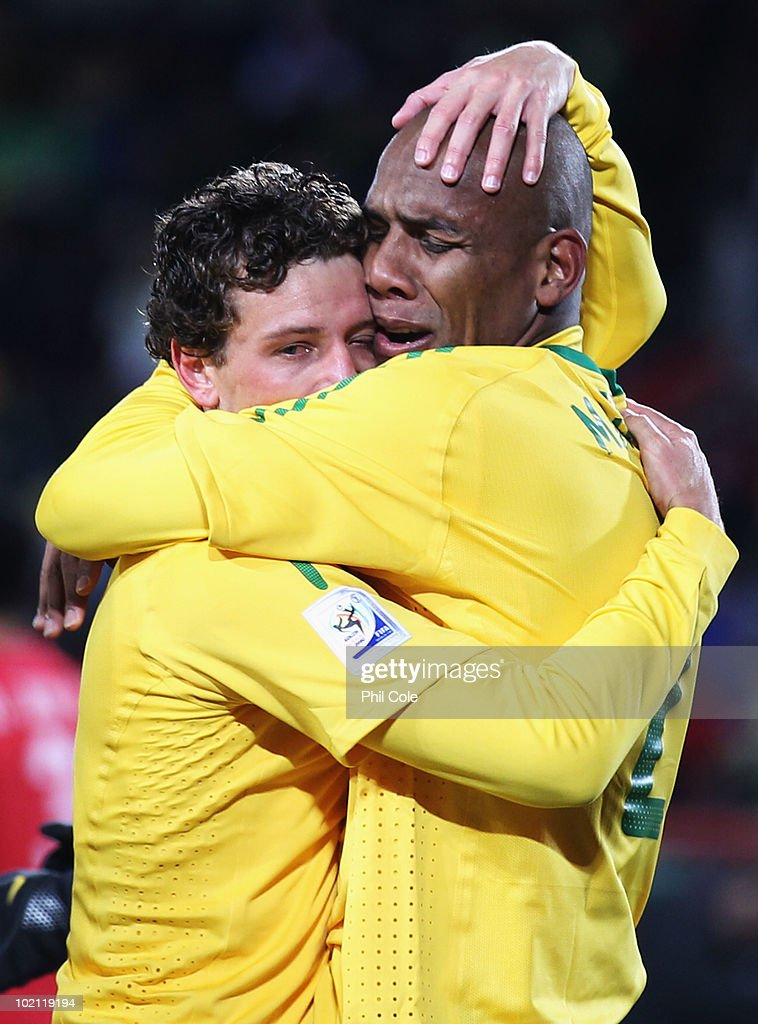 Maicon of Brazil celebrates scoring the first goal with team mate Elano (L) during the 2010 FIFA World Cup South Africa Group G match between Brazil and North Korea at Ellis Park Stadium on June 15, 2010 in Johannesburg, South Africa.