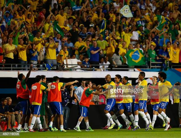 Maicon of Brazil celebrates with his teammates on the bench after scoring a goal in the second half against Honduras during a friendly match at Sun...
