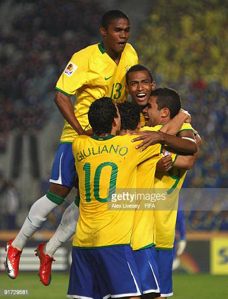 Maicon of Brazil celebrates with team mates after scoring his second goal during the FIFA U20 World Cup Quarter Final match between Brazil and...