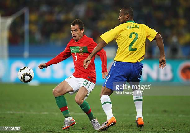 Maicon of Brazil challenges Duda of Portugal during the 2010 FIFA World Cup South Africa Group G match between Portugal and Brazil at Durban Stadium...