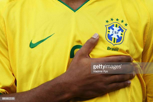 Maicon of Brazil holds his hand on his breast during the national anthems ahead to the FIFA Confederations Cup match between USA and Brazil at Loftus...