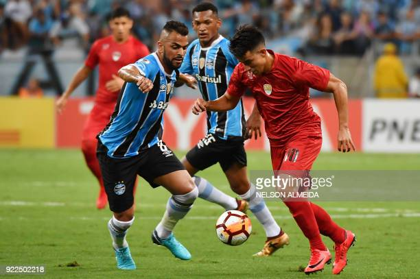 Maicon of Brazils Gremio vies for the ball with Fernando Gaibor of Argentina's Independiente during their Recopa Sudamericana 2018 second leg final...
