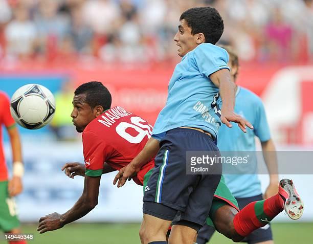 Maicon of FC Lokomotiv Moscow battles for the ball with Ibragim Tsallagov of FC Krylia Sovetov Samara during the Russian Premier League match between...