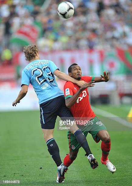 Maicon of FC Lokomotiv Moscow battles for the ball with Yevgeni Balyaikin FC Krylia Sovetov Samara during the Russian Premier League match between FC...