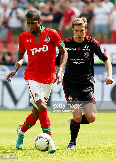 Maicon of FC Lokomotiv Moscow is challenged by Kirill Nababkin of PFC CSKA Moscow during the Russian Premier League match between FC Lokomotiv Moscow...