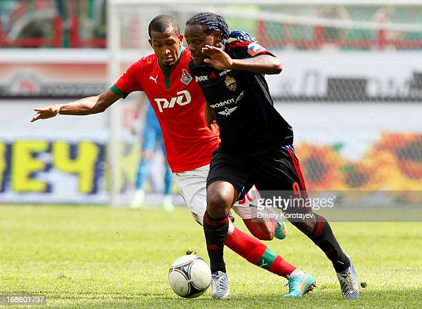 Maicon of FC Lokomotiv Moscow is challenged by Vagner Love of PFC CSKA Moscow during the Russian Premier League match between FC Lokomotiv Moscow and...