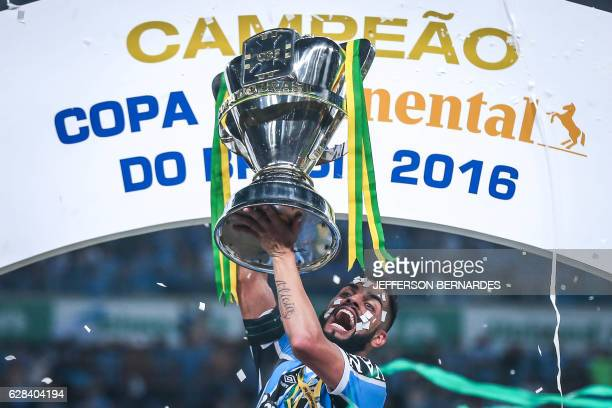 Maicon of Gremio celebrates with the trophy the championship Copa do Brasil 2016 at Arena do Gremio on December 07 2016 in Porto Alegre Brazil Gremio...