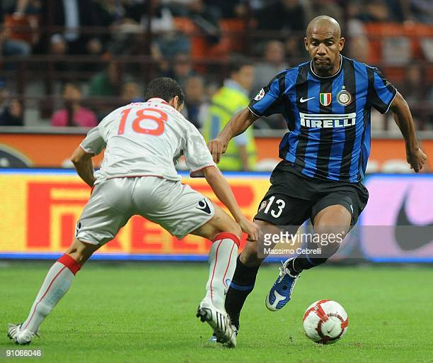 Maicon of Inter Milan and Mariano Bogliacino of SSC Napoli compete for the ball during the Serie A match between FC Inter Milan and SSC Napoli at...