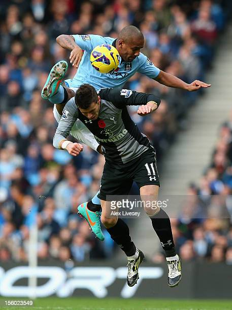 Maicon of Manchester City tangles in the air with Gareth Bale of Tottenham Hotspur during the Barclays Premier League match between Manchester City...