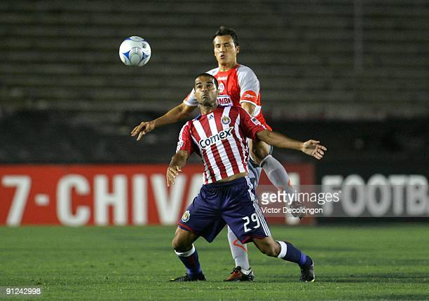 Maicon Santos of Chivas USA plays the ball in front of Aaron Galindo of Chivas de Guadalajara during the International Club Friendly at the Rose Bowl...