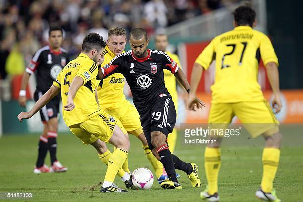 Maicon Santos of DC United controls the ball against Danny O'Rourke of the Columbus Crew at RFK Stadium on October 20 2012 in Washington DC