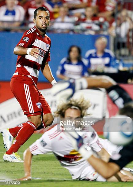 Maicon Santos of the FC Dallas watches as his shot goes wide of the net as Stephen Keel and goalkeeper Alex Horwath of the New York Red Bulls attempt...