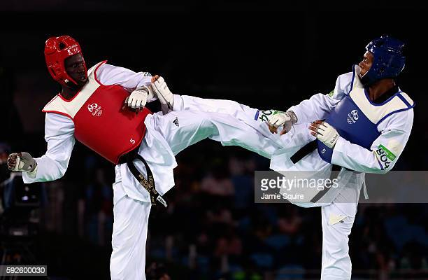 Maicon Siqueira of Brazil competes against M'Bar N'Diaye of France during the Men's 80kg Repechage contest on Day 15 of the Rio 2016 Olympic Games at...