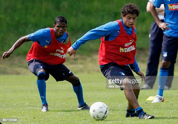 Maicosuel and Carlos Eduardo run after the ball during a training session of 1899 Hoffenheim during a training camp on July 1, 2009 in Stahlhofen am...