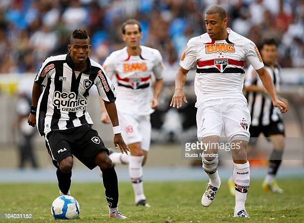 Maicosuel of Botafogo fights for the ball with Jorge Wagner of Sao Paulo during a match as part of the Brazilian Championship Serie A at Engenhao...