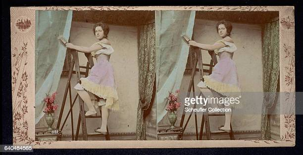 A maid at work dusts the drapes ca 18751890
