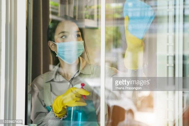maid cleaning windows - メイド ストックフォトと画像