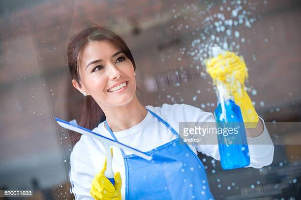 maid cleaning windows - window cleaning stock photos and pictures