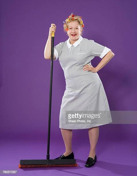 Maid holding broom, portrait