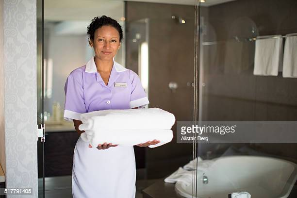 maid in doorway of bathroom - maid stock pictures, royalty-free photos & images
