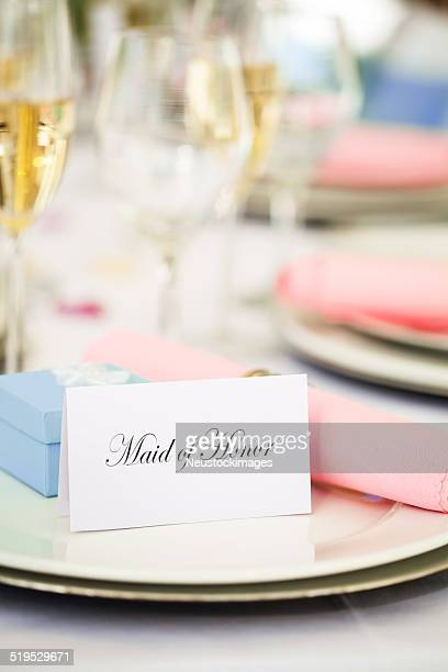 """""""maid of honor"""" place card, wedding favor on plate - bridesmaid stock pictures, royalty-free photos & images"""
