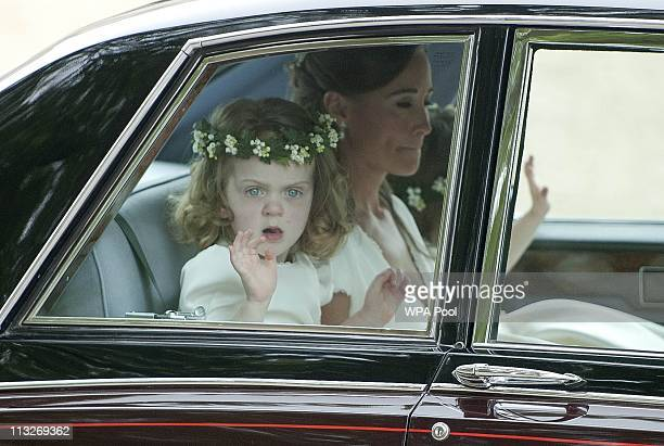 Maid of Honour Pippa Middleton and bridesmaid Grace van Cutsem make their way to Westminster Abbey on April 29 2011 in London England The marriage of...