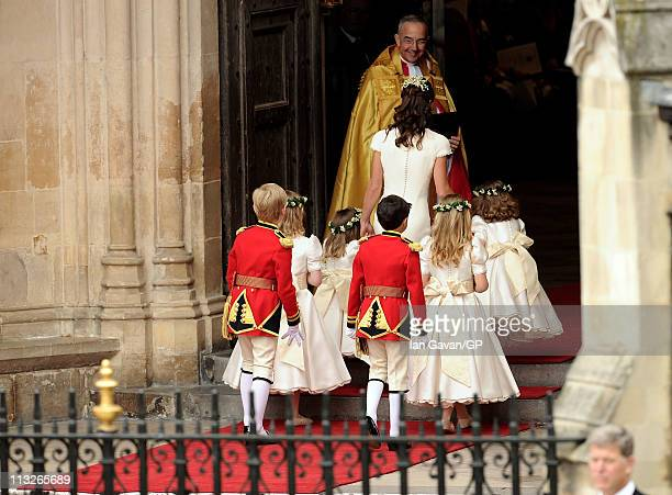 Maid of Honour Pippa Middleton with pageboys Master William LowtherPinkerton Master Tom Pettifer and bridemaids The Lady Louise WindsorThe Hon...